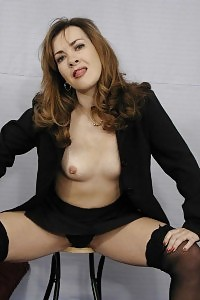 Perverted Mature With Small Assets Posing Temptingly