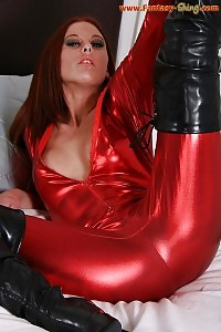 Lea Enchantingly Raises Her Legs Up And Does Smooth Strip Tease In Her Red Latex Uniform