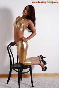 Brunette Emmeline Reveals Her Captivating Ass And Sexy Legs Clothed In Shiny Outfit