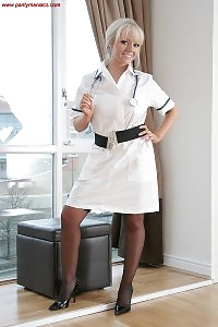 Nurse Claire Demonstrates Her Charming Body As She Kneels On The Floor