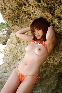 Asian Chick Likes Being Nude At The Seaside Exploring Hairy Cunt Off For Photos