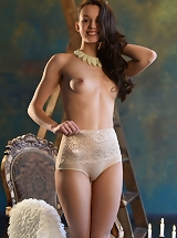 Starlet strips her white long gown baring her smooth erotic body, tasty ass and firm pussy as she pose on the chair.